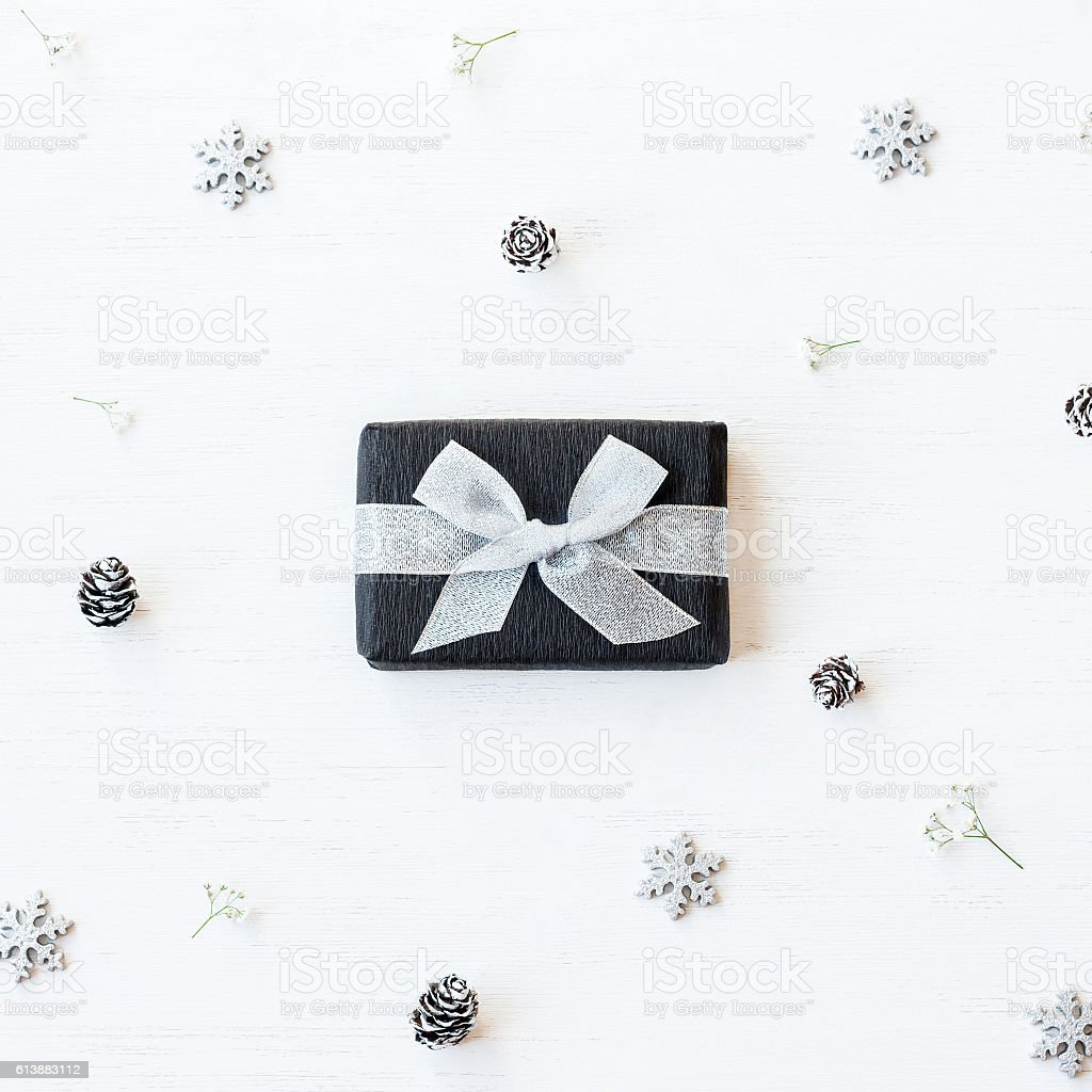 Christmas gift, snowflakes, pine cones and gypsophila flowers stock photo