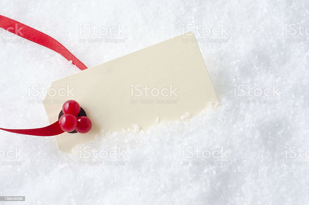 Christmas Gift Tag in Snow royalty-free stock photo