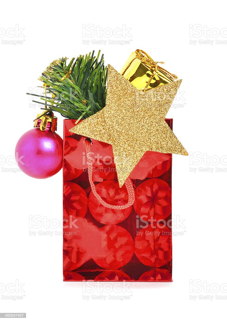 Christmas gift with baubles, pine twig royalty-free stock photo
