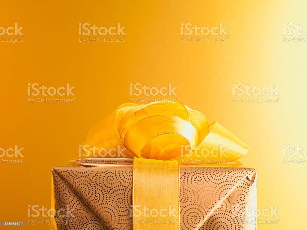 Christmas gift with gold ribbon stock photo