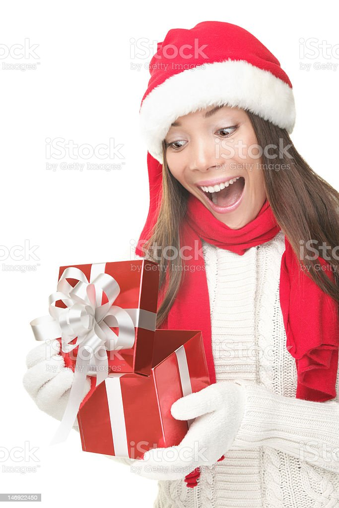 Christmas gift woman opening present surprised stock photo