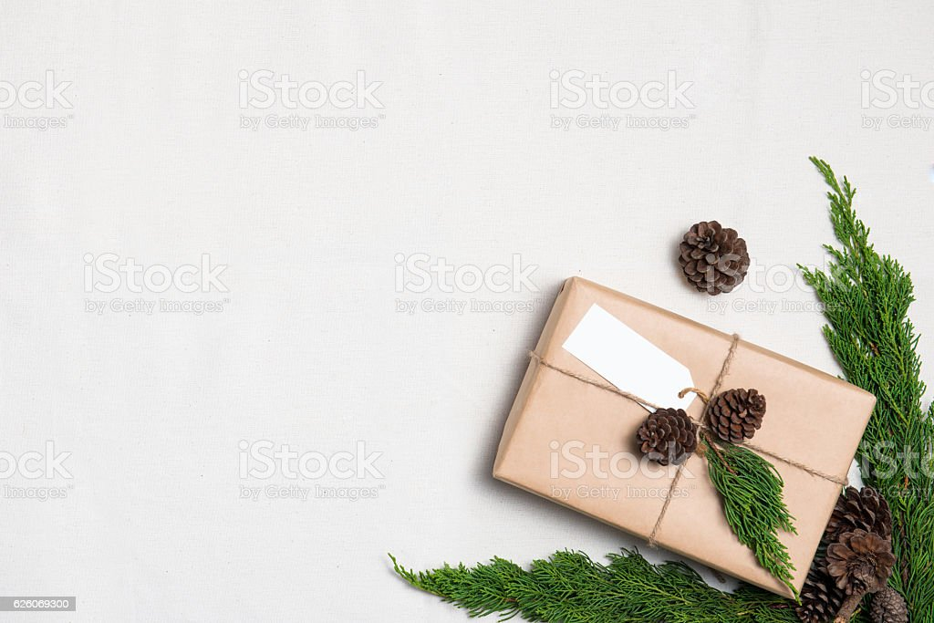 Christmas gift wrapped in brown paper stock photo