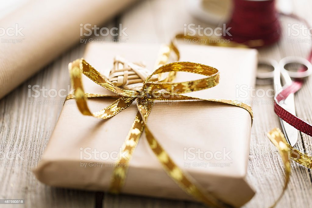 christmas gift wrapped in eco-paper stock photo