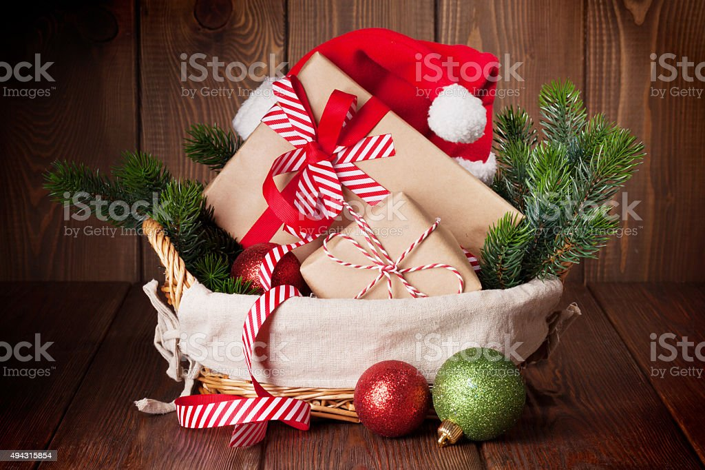 Christmas gifts and tree branch stock photo