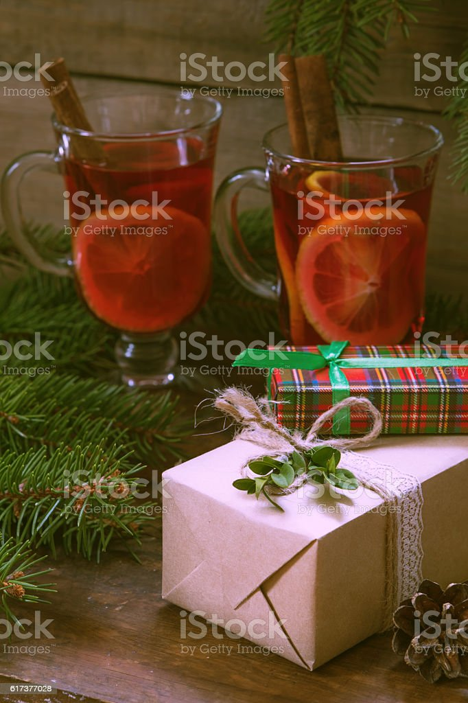 Christmas gifts and two glasses of hot mulled wine stock photo