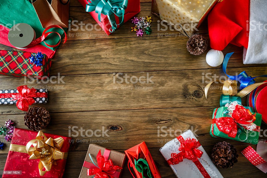 Christmas Gifts decor making a frame on a wood background stock photo