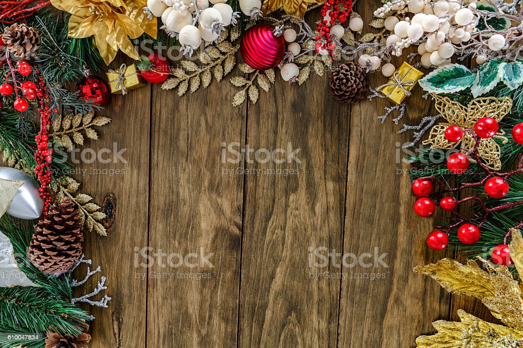 Christmas Gifts decor making a partial frame on wood background stock photo
