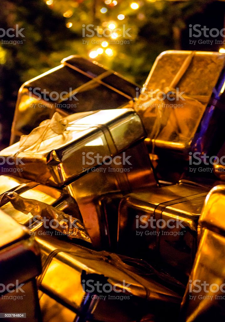Christmas Gifts in gold colours stock photo