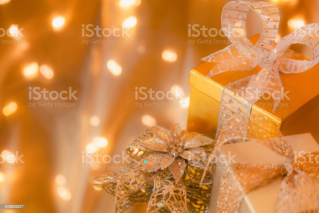 Christmas gifts in silver and gold with gold background (P) stock photo