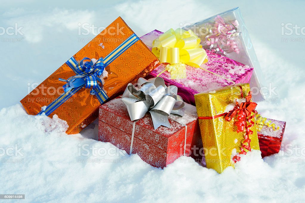 Christmas gifts in the snow stock photo