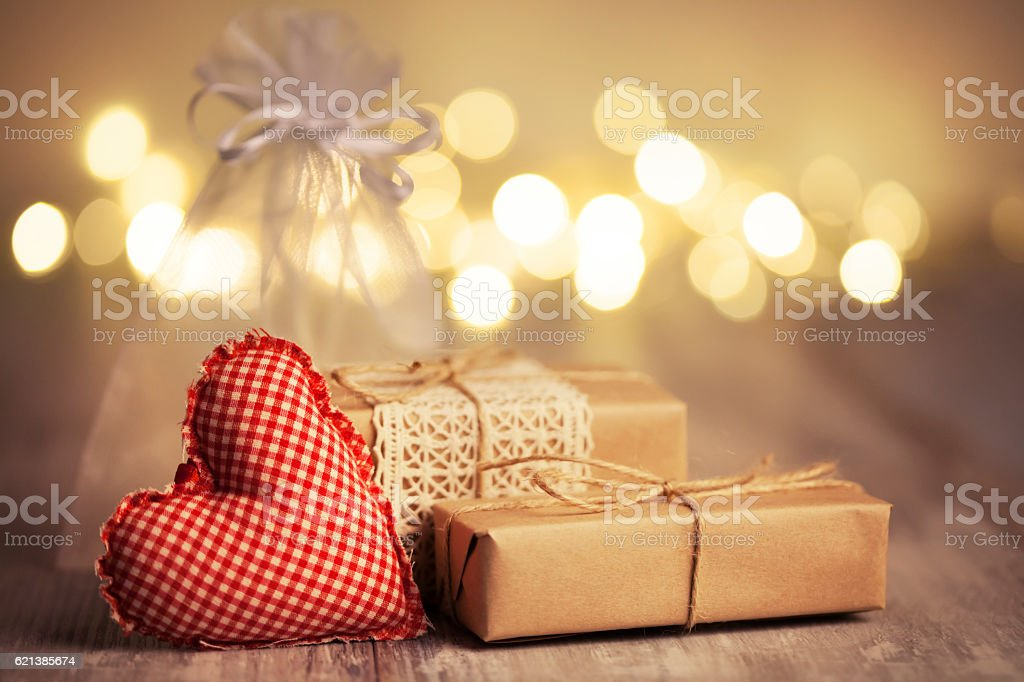 Christmas gifts on defocused gold background stock photo