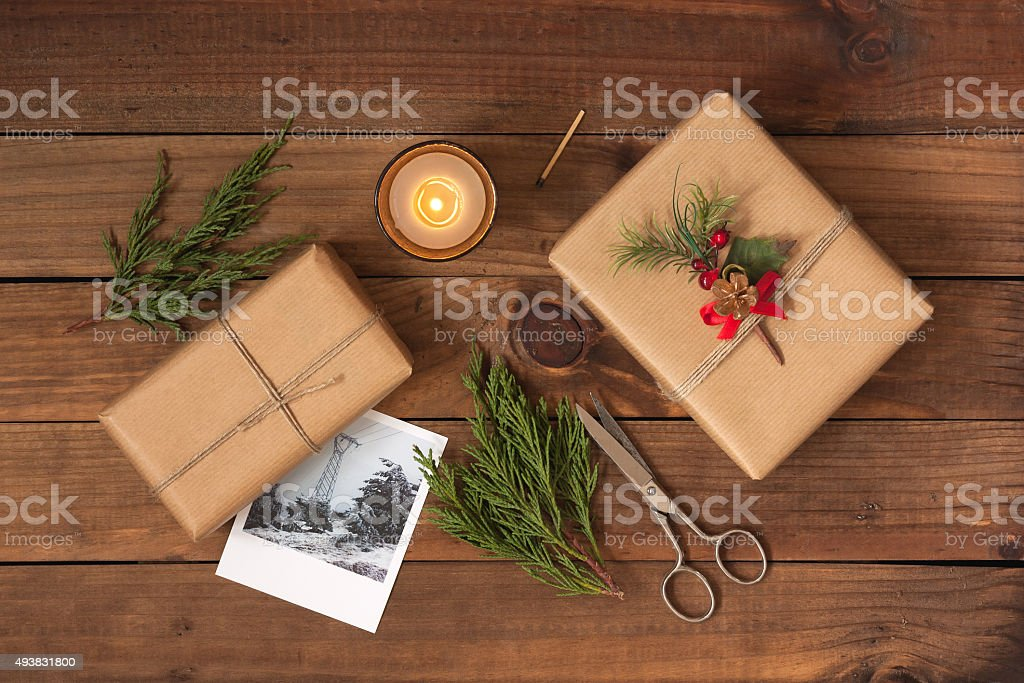Christmas gifts on rustic wooden background stock photo