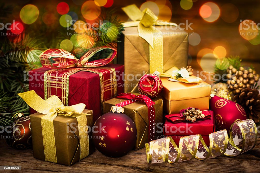 Christmas gifts on the wooden background stock photo