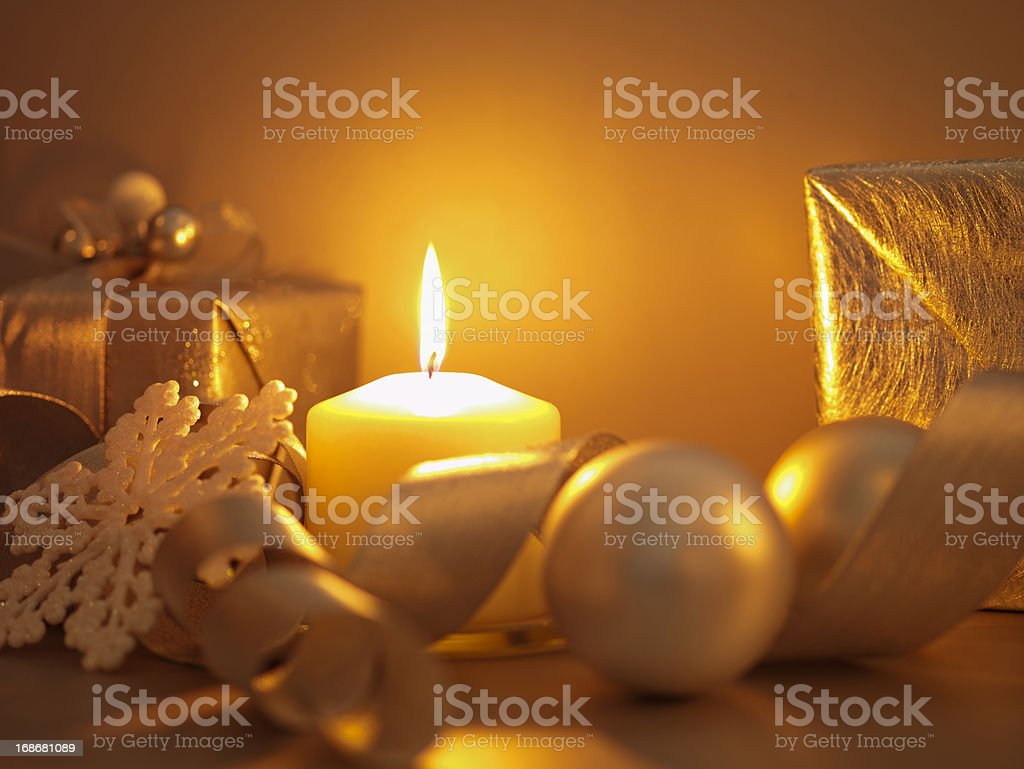 Christmas gifts, ornaments and candle royalty-free stock photo