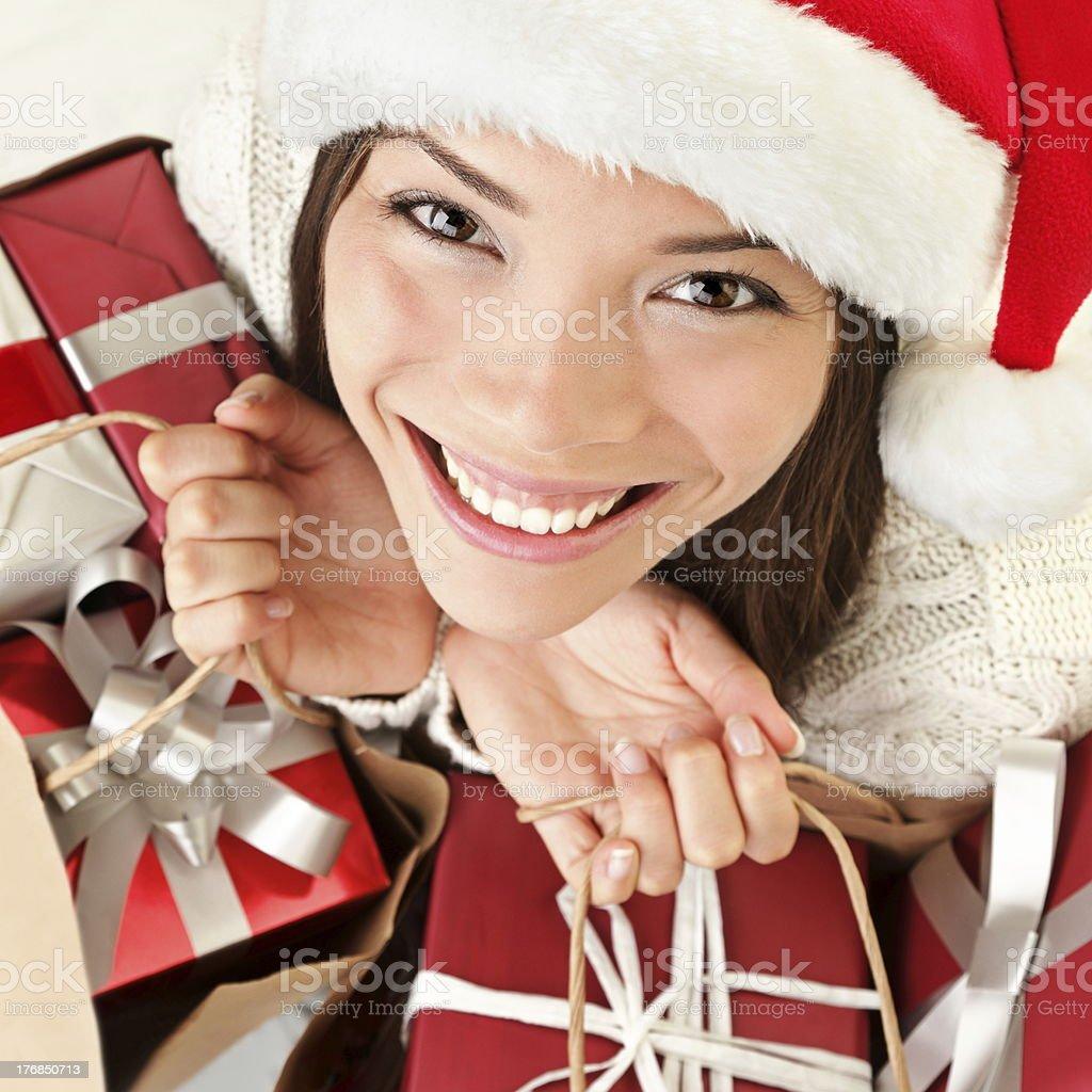 Christmas gifts santa woman shopping royalty-free stock photo