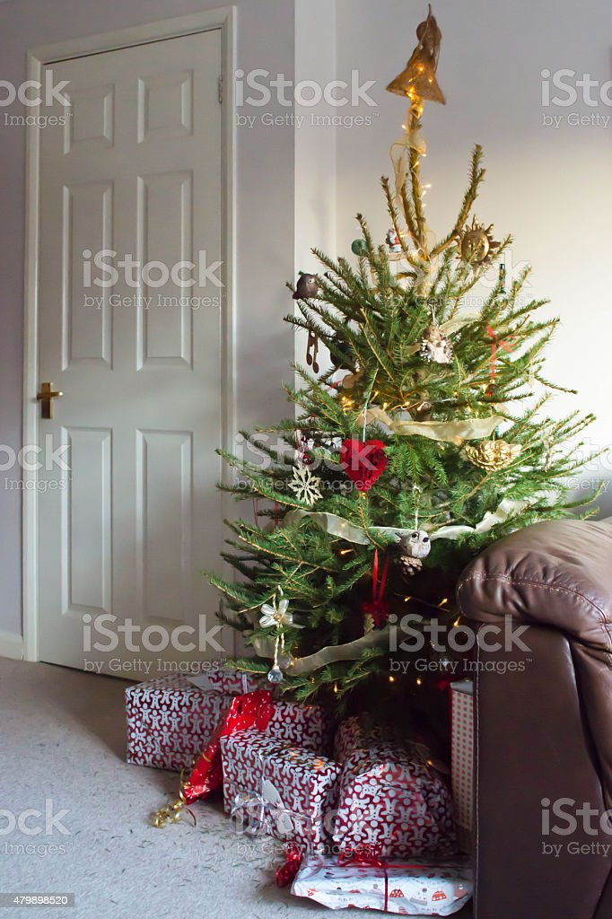 Christmas gifts under a tree stock photo