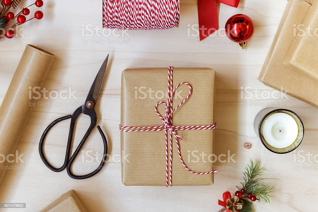 Christmas gifts wrapped in kraft paper tied with string stock photo