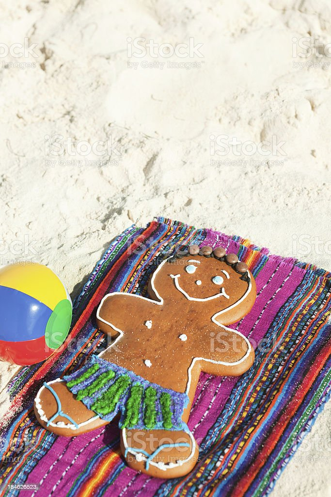 Christmas Ginger Bread Man Winter Vacation on Tropical Beach royalty-free stock photo