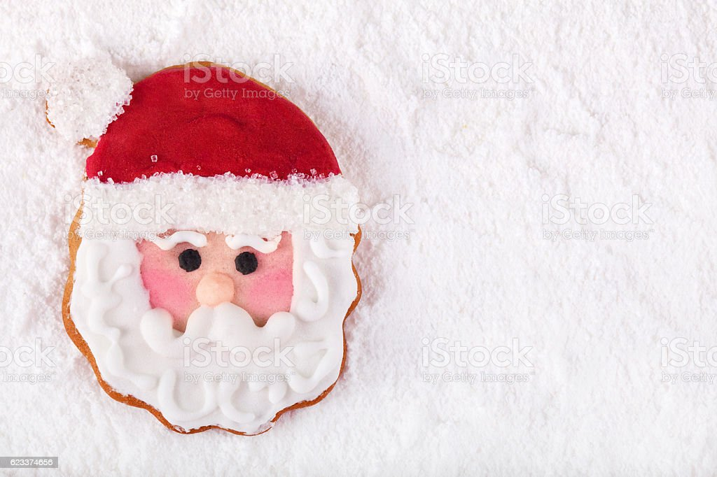 Christmas Gingerbread cookie Santa Claus on snow stock photo