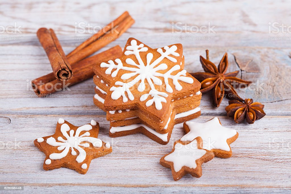 Christmas gingerbread cookie stars on wooden table stock photo