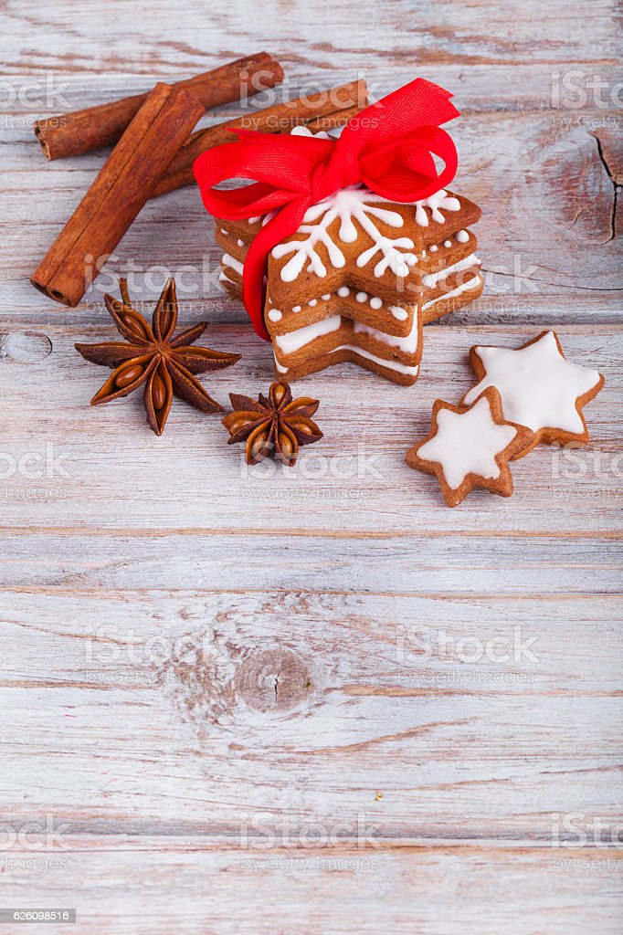 Christmas gingerbread cookie stars on wooden table. stock photo
