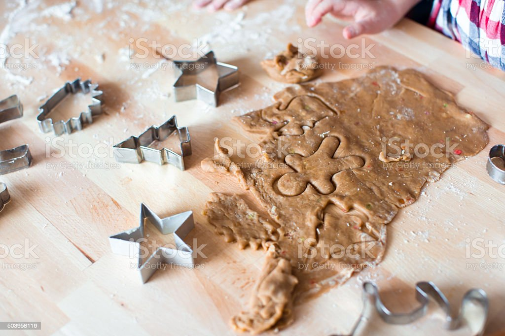 Christmas gingerbread cookies and molds for baking on Xmas eve stock photo