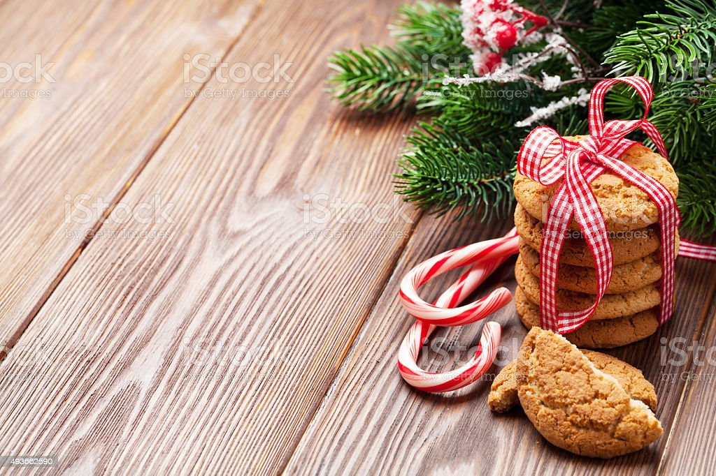 Christmas gingerbread cookies, candy cane and tree stock photo