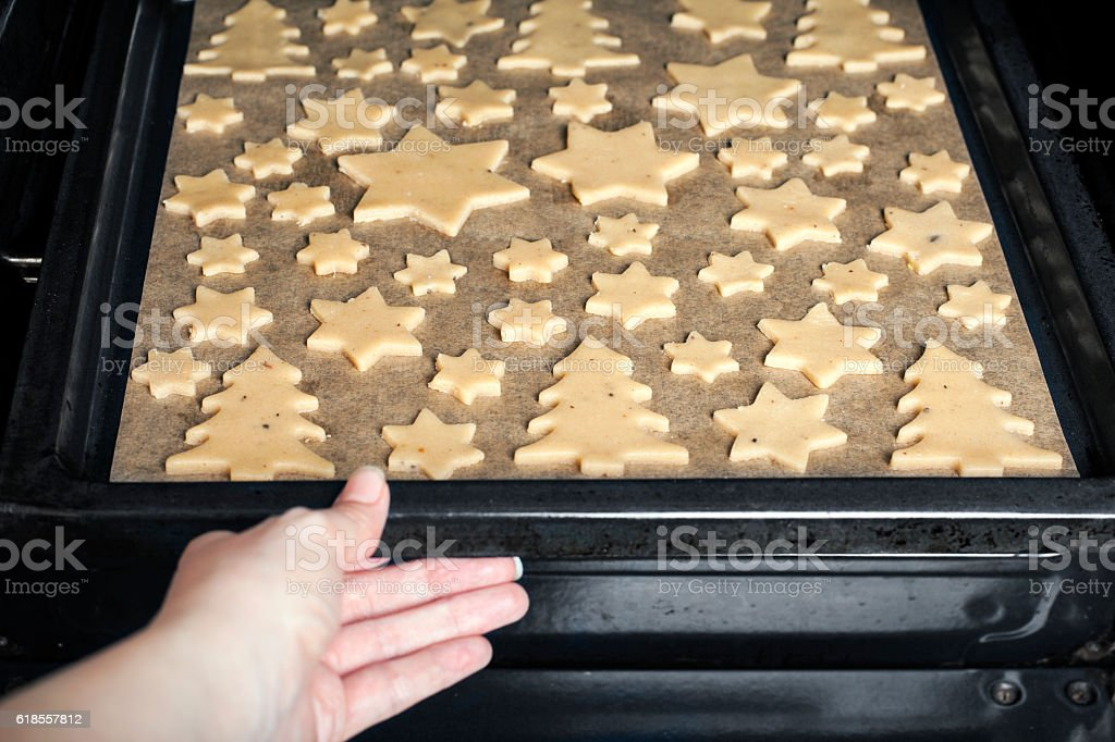 Christmas gingerbread cookies in the oven stock photo