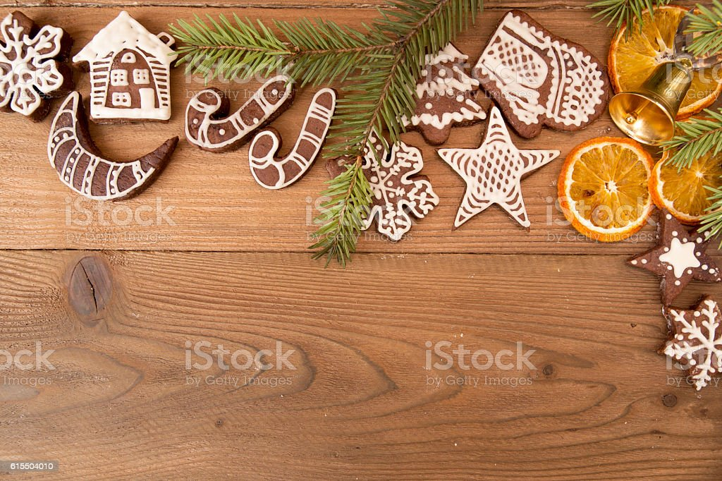 Christmas gingerbread cookies on old wooden table. stock photo