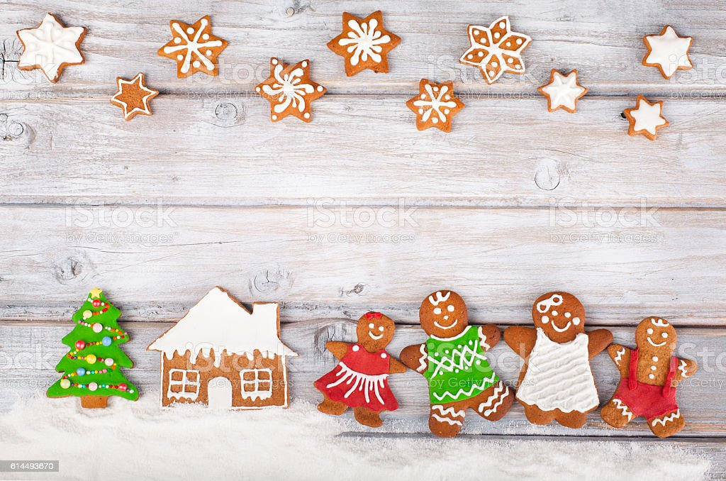Christmas gingerbread cookies on white vintage wooden table stock photo
