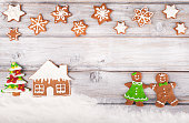 Christmas gingerbread cookies on white vintage wooden table
