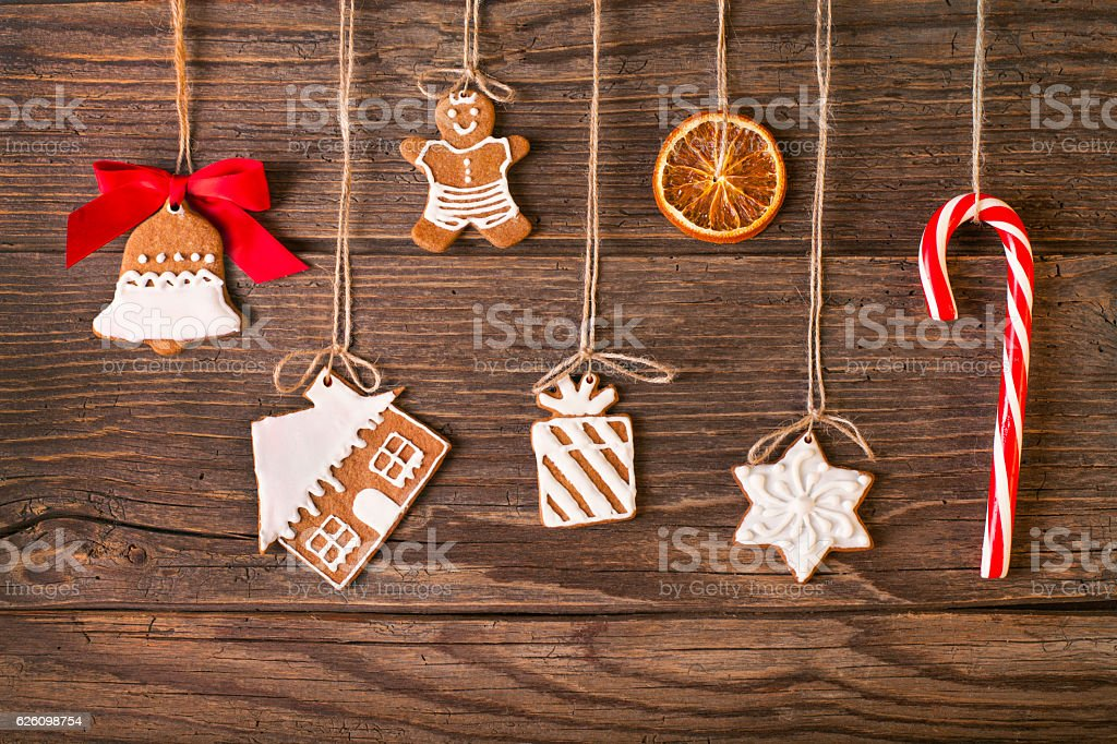 Christmas gingerbread cookies on wood background stock photo
