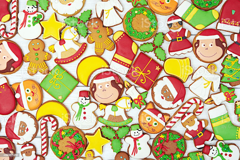 Christmas gingerbread cookies on wooden background stock photo