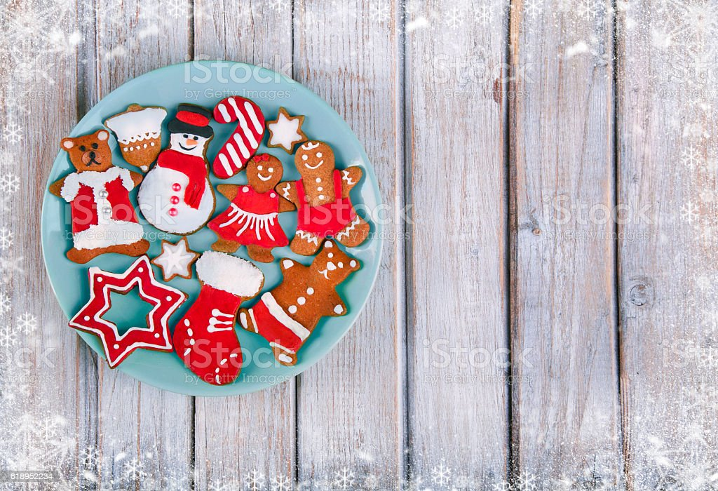Christmas gingerbread cookies on wooden table stock photo