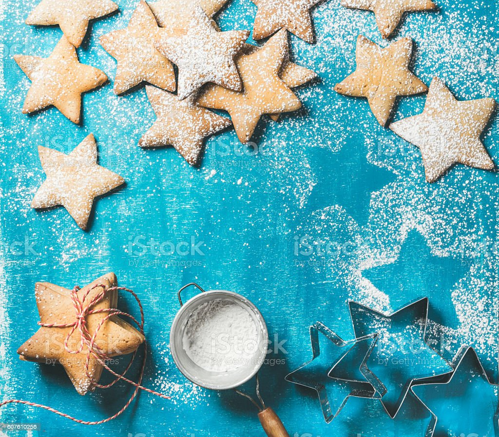 Christmas gingerbread cookies with sugar powder and metal shapes stock photo