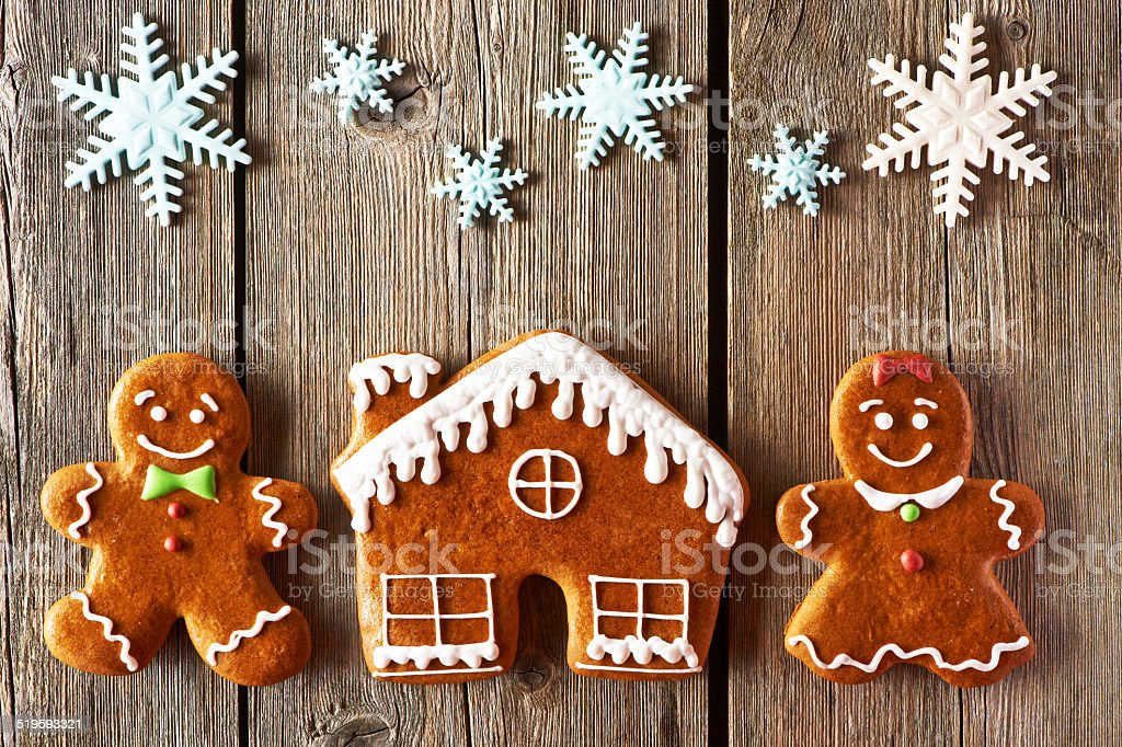 Christmas gingerbread couple and house cookies stock photo