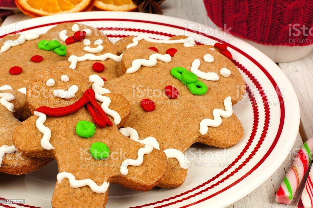 Christmas gingerbread man cookies on a plate close up stock photo