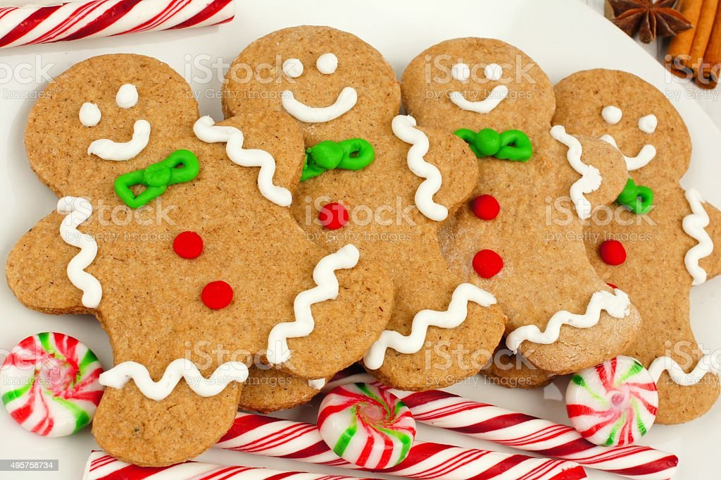Christmas gingerbread man cookies on plate with candy stock photo