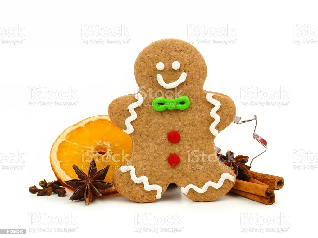 Christmas gingerbread man with holiday spices over white stock photo
