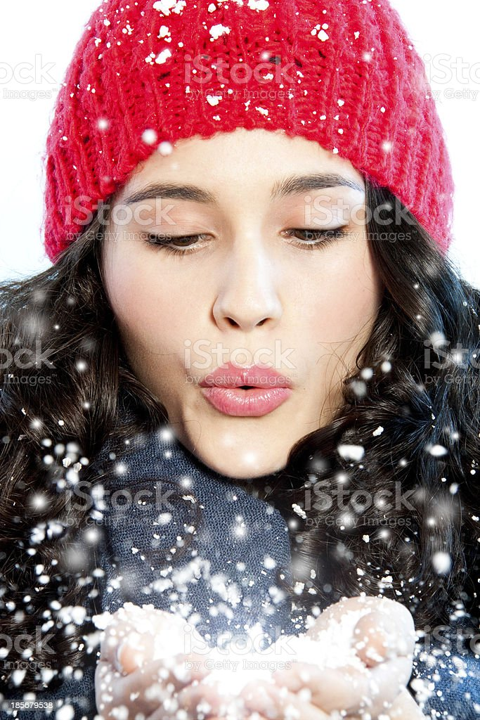 Christmas girl blowing snow in hands royalty-free stock photo