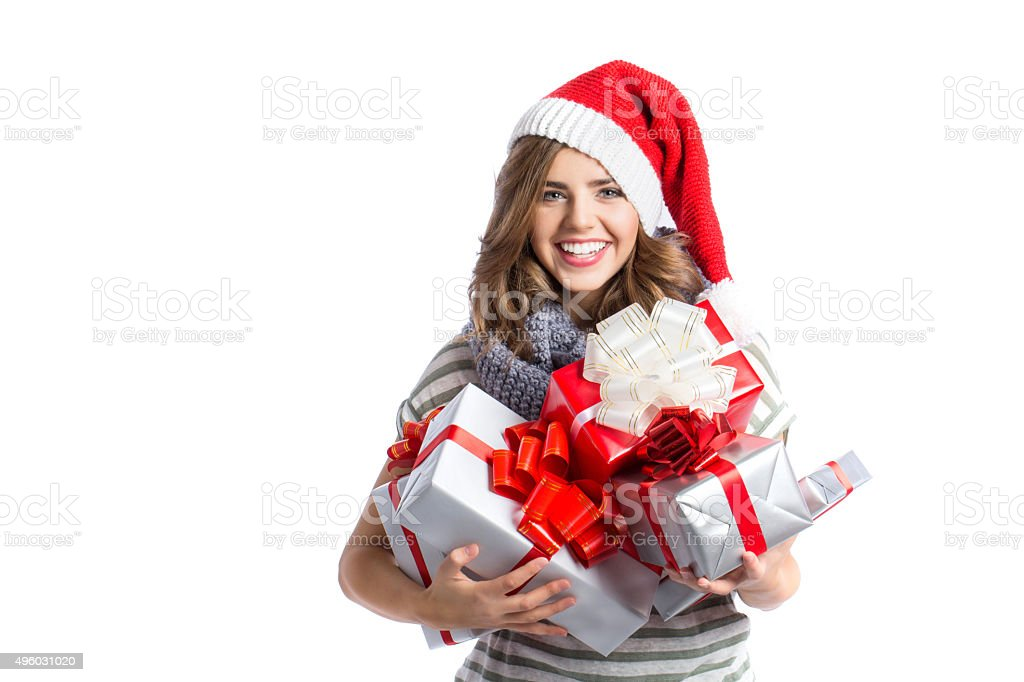 Christmas girl holding a lot of gifts. stock photo