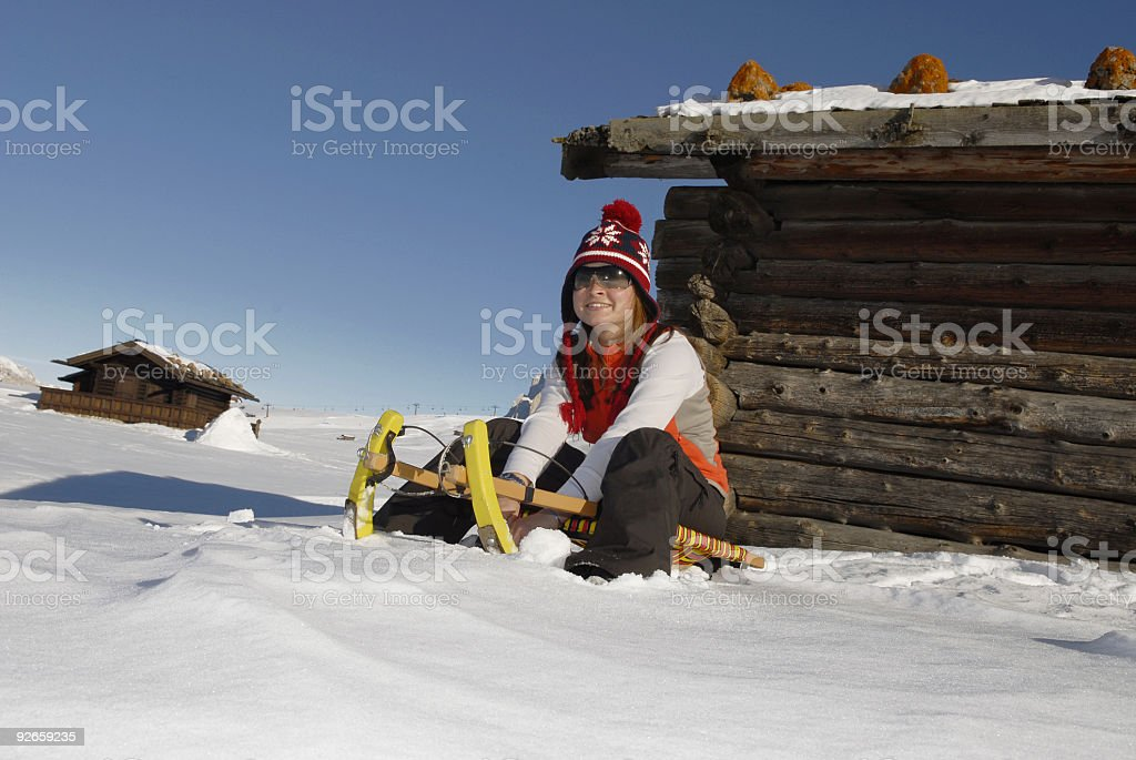 Christmas girl on the sled stock photo