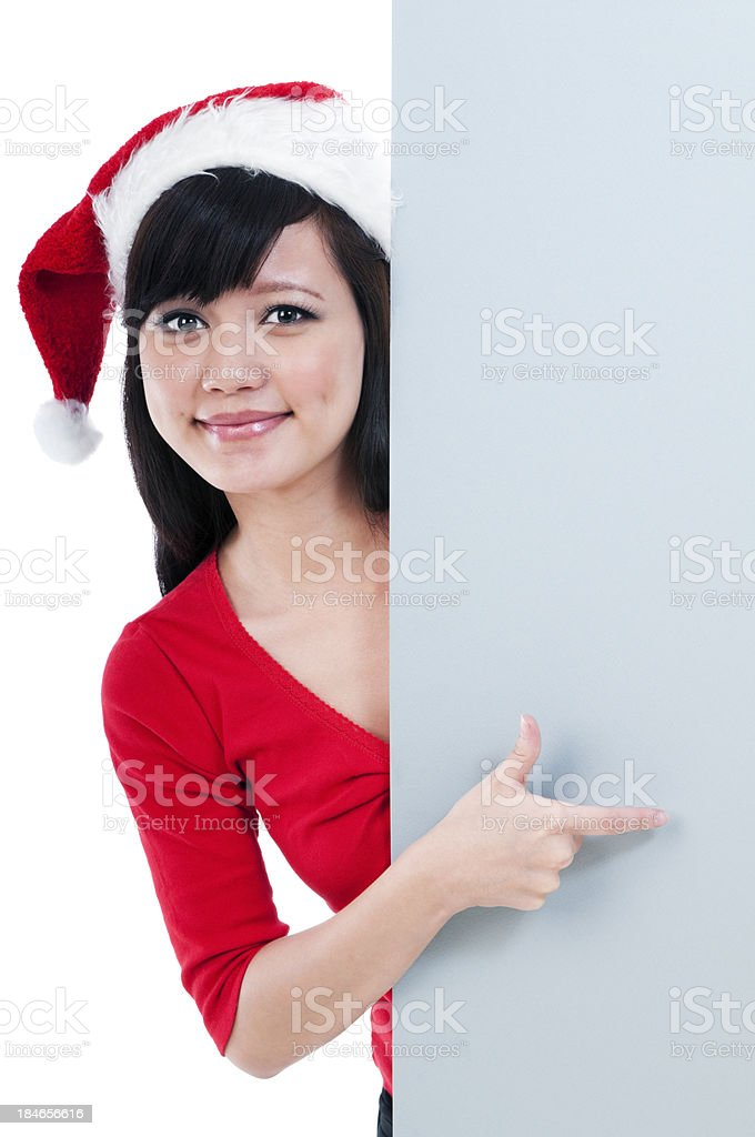 Christmas Girl Pointing At Billboard stock photo