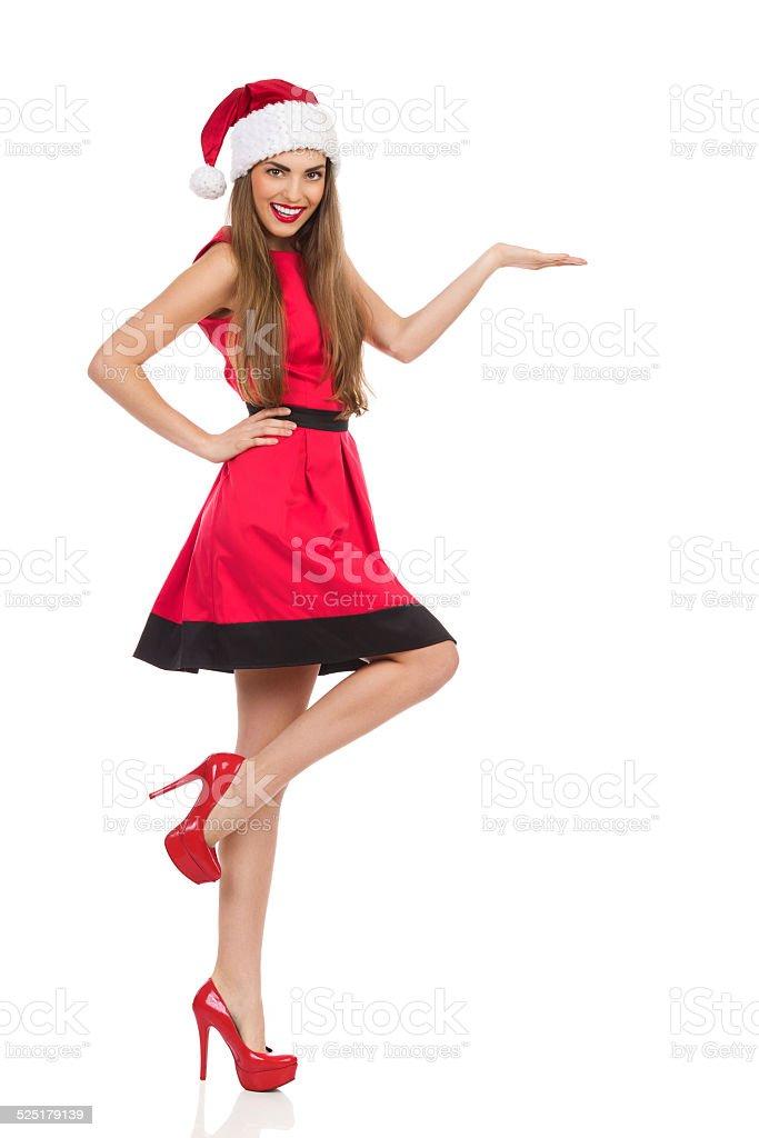 Christmas girl presenting product stock photo
