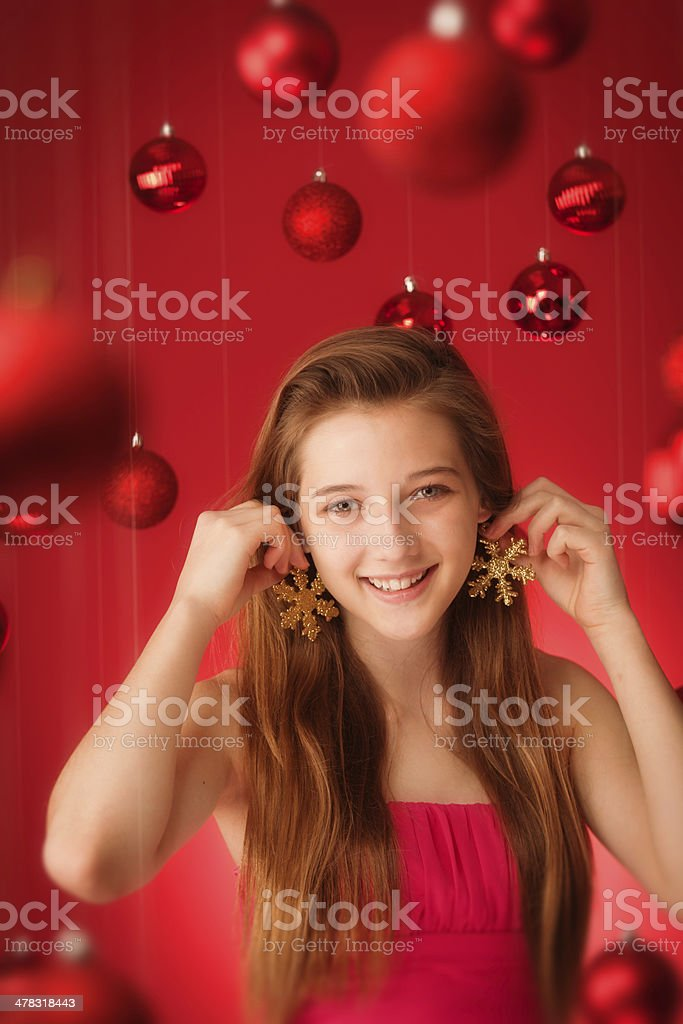 Christmas Girl with Gold Snow Flakes Decorations Vt royalty-free stock photo