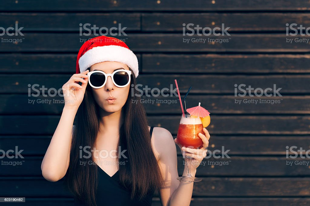 Christmas Girl with Sunglasses Holding Cocktail stock photo