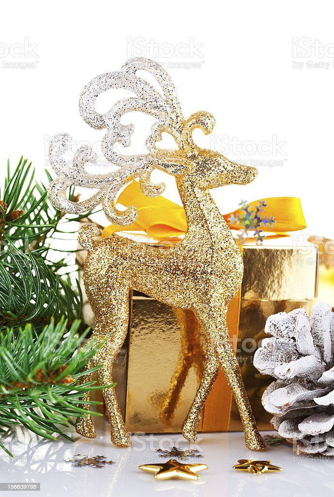 christmas gold deer with branch firtree and gift royalty-free stock photo