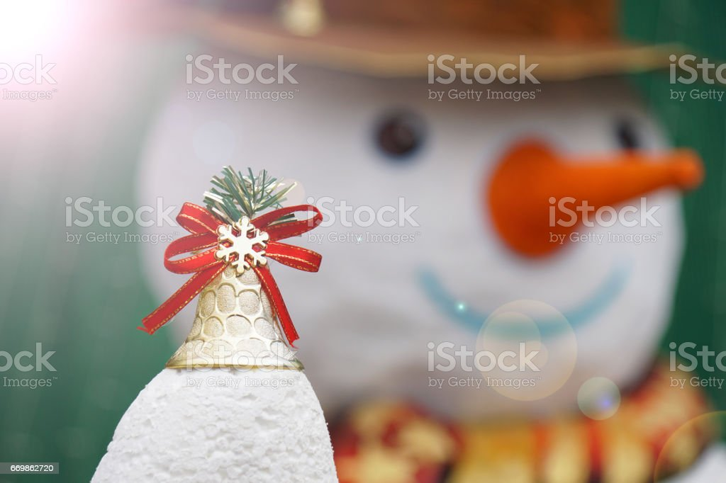 Christmas Golden Bell with snowman and flare effect stock photo