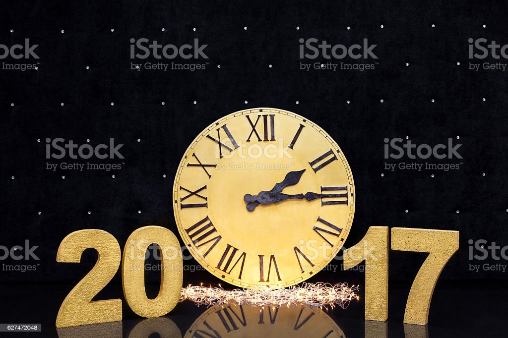 Christmas golden watch on black background. new year 2017 stock photo