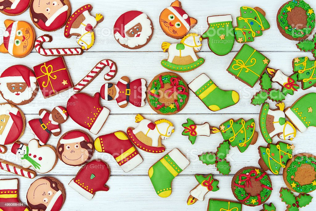 Christmas green and red gingerbread cookies on wooden background stock photo